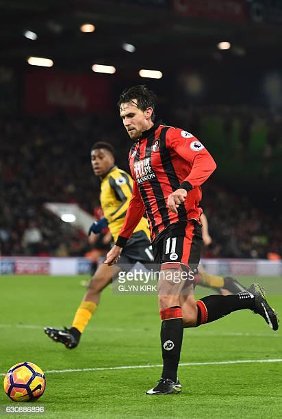 Bournemouth's English midfielder Charlie Daniels runs with the ball during the English Premier League football match between Bournemouth and Arsenal...