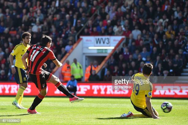 Bournemouth's English midfielder Charlie Daniels shoots and scores past Middlesbrough's English midfielder Stewart Downing during the English Premier...