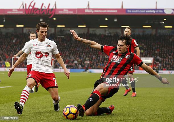 Bournemouth's English midfielder Charlie Daniels tries to cross the ball past Southampton's German-born Portuguese defender Cedric Soares during the...