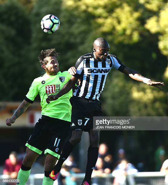 Bournemouth's English midfielder Charlie Daniels vies for the ball with Angers' Cameroun forward Karl Toko Ekambi during the International friendly...