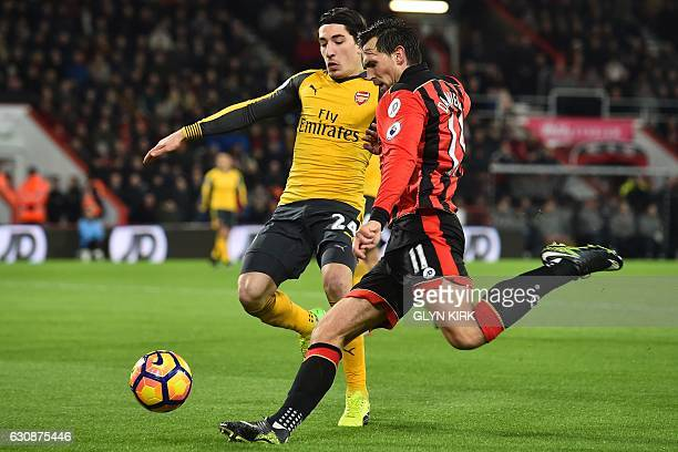 Bournemouth's English midfielder Charlie Daniels vies with Arsenal's Spanish defender Hector Bellerin during the English Premier League football...