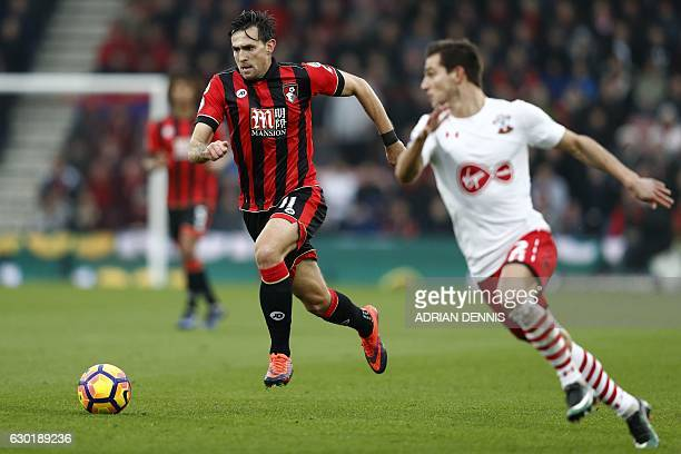 Bournemouth's English midfielder Charlie Daniels vies with Southampton's German-born Portuguese defender Cedric Soares during the English Premier...