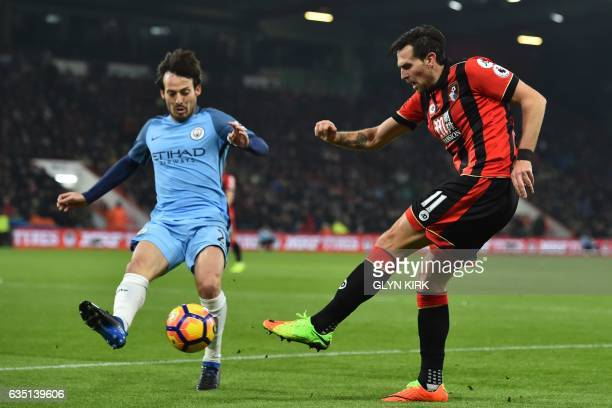 Bournemouth's English midfielder Charlie Daniels vies with Manchester City's Spanish midfielder David Silva during the English Premier League...