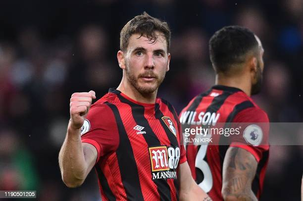 Bournemouth's English midfielder Dan Gosling celebrates scoring his team's first goal during the English Premier League football match between...
