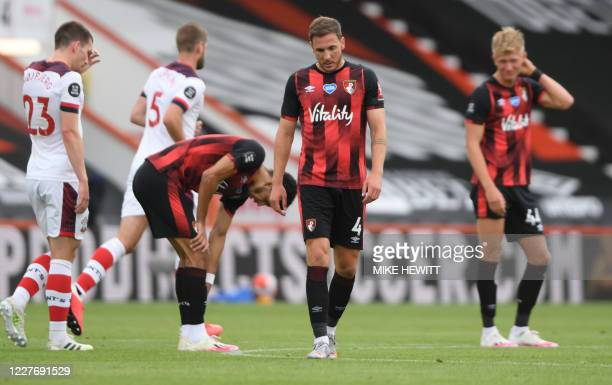 Bournemouth's English midfielder Dan Gosling leaves the pitch at the end of the English Premier League football match between Bournemouth and...