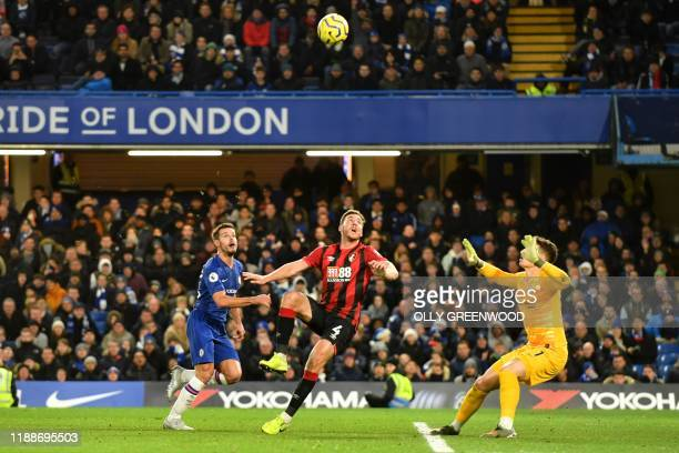 Bournemouth's English midfielder Dan Gosling scores his team's first goal ruled offside but overruled by VAR during the English Premier League...