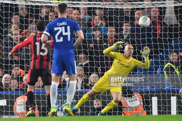 Bournemouth's English midfielder Dan Gosling scores the team's first goal past Chelsea's Argentinian goalkeeper Willy Caballero during the English...