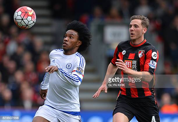 Bournemouth's English midfielder Dan Gosling vies with Chelsea's Brazilian midfielder Willian during the English Premier League football match...