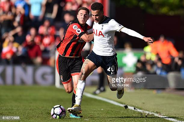 Bournemouth's English midfielder Dan Gosling vies with Tottenham Hotspur's English midfielder Dele Alli during the English Premier League football...