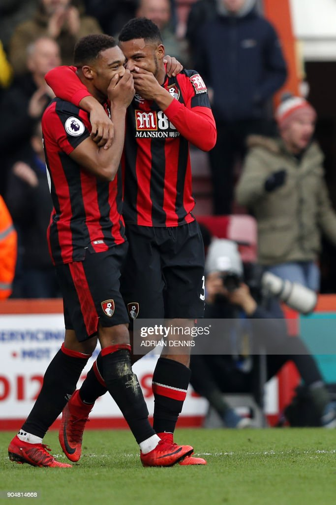 Bournemouth's English midfielder Jordon Ibe (L) celebrates with Bournemouth's French midfielder Lys Mousset for scoring the team's second goal during the English Premier League football match between Bournemouth and Arsenal at the Vitality Stadium in Bournemouth, southern England on January 14, 2018. / AFP PHOTO / Adrian DENNIS / RESTRICTED TO EDITORIAL USE. No use with unauthorized audio, video, data, fixture lists, club/league logos or 'live' services. Online in-match use limited to 75 images, no video emulation. No use in betting, games or single club/league/player publications. /