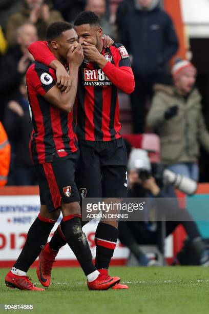 Bournemouth's English midfielder Jordon Ibe celebrates with Bournemouth's French midfielder Lys Mousset for scoring the team's second goal during the...