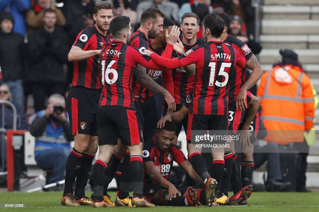 Bournemouth's English midfielder Jordon Ibe (Bottom) celebrates with teammates scoring the team's second goal during the English Premier League football match between Bournemouth and Arsenal at the Vitality Stadium in Bournemouth, southern England on January 14, 2018. / AFP PHOTO / Adrian DENNIS / RESTRICTED TO EDITORIAL USE. No use with unauthorized audio, video, data, fixture lists, club/league logos or 'live' services. Online in-match use limited to 75 images, no video emulation. No use in betting, games or single club/league/player publications. /
