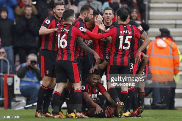 Bournemouth's English midfielder Jordon Ibe celebrates with teammates scoring the team's second goal during the English Premier League football match...