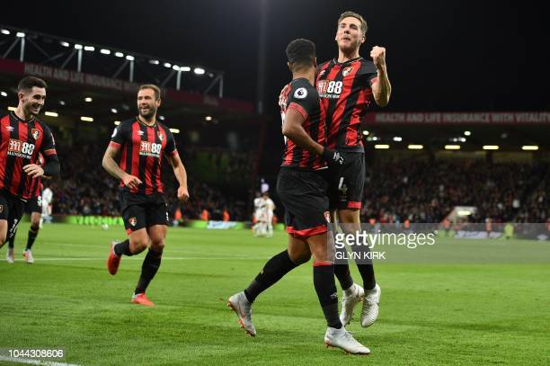 Bournemouth's English midfielder Junior Stanislas celebrates scoring his team's second goal from the penalty spot during the English Premier League...