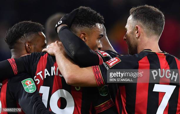 TOPSHOT Bournemouth's English midfielder Junior Stanislas celebrates scoring the opening goal during the English League cup fourth round football...