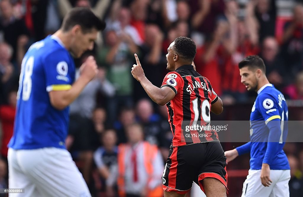 Bournemouth's English midfielder Junior Stanislas (C) celebrates scoring his team's first goal during the English Premier League football match between Bournemouth and Everton at the Vitality Stadium in Bournemouth, southern England on September 24, 2016. / AFP / Glyn KIRK / RESTRICTED TO EDITORIAL USE. No use with unauthorized audio, video, data, fixture lists, club/league logos or 'live' services. Online in-match use limited to 75 images, no video emulation. No use in betting, games or single club/league/player publications. /
