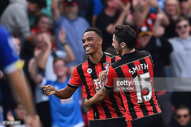Bournemouth's English midfielder Junior Stanislas celebrates with Bournemouth's English defender Adam Smith after scoring his team's first goal...