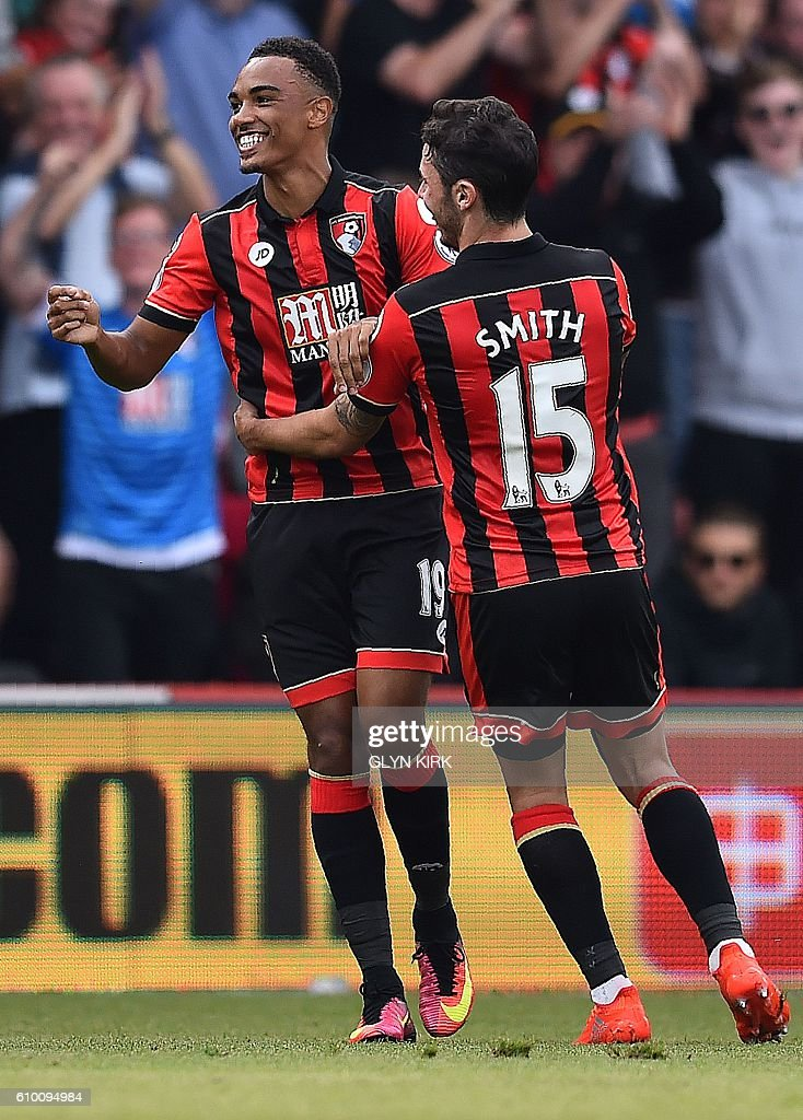 Bournemouth's English midfielder Junior Stanislas (L) celebrates with Bournemouth's English defender Adam Smith after scoring his team's first goal during the English Premier League football match between Bournemouth and Everton at the Vitality Stadium in Bournemouth, southern England on September 24, 2016. / AFP / Glyn KIRK / RESTRICTED TO EDITORIAL USE. No use with unauthorized audio, video, data, fixture lists, club/league logos or 'live' services. Online in-match use limited to 75 images, no video emulation. No use in betting, games or single club/league/player publications. /