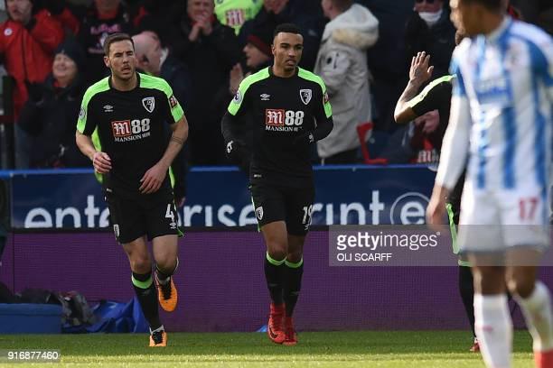 Bournemouth's English midfielder Junior Stanislas celebrates with Bournemouth's English midfielder Dan Gosling scoring the team's first goal during...