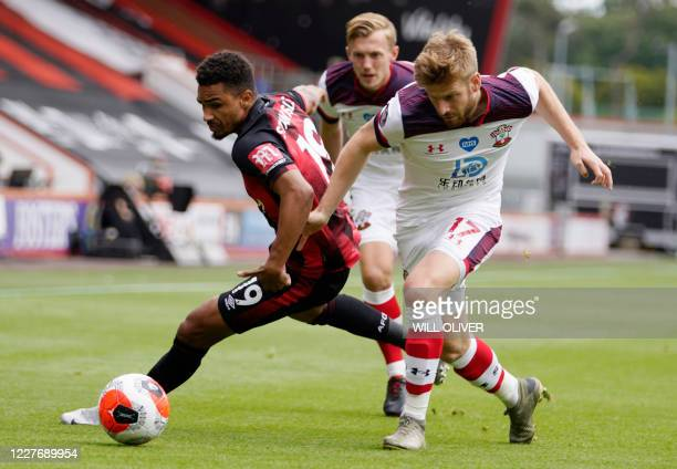 Bournemouth's English midfielder Junior Stanislas fights for the ball with Southampton's Scottish midfielder Stuart Armstrong during the English...