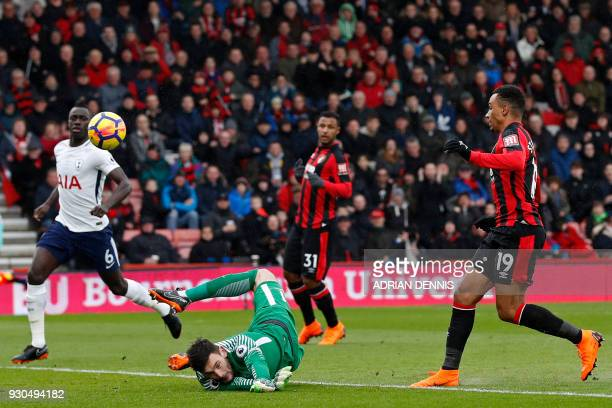 TOPSHOT Bournemouth's English midfielder Junior Stanislas hits the bar with this early attempt during the English Premier League football match...