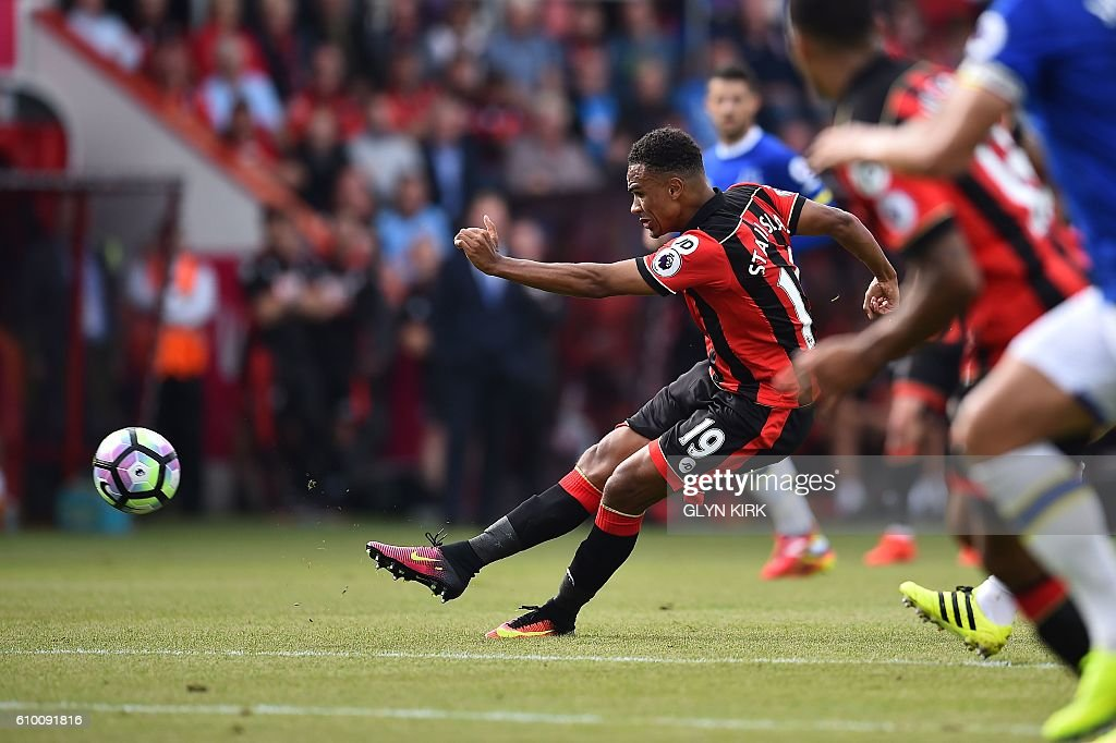 Bournemouth's English midfielder Junior Stanislas scores his team's first goal during the English Premier League football match between Bournemouth and Everton at the Vitality Stadium in Bournemouth, southern England on September 24, 2016. / AFP / Glyn KIRK / RESTRICTED TO EDITORIAL USE. No use with unauthorized audio, video, data, fixture lists, club/league logos or 'live' services. Online in-match use limited to 75 images, no video emulation. No use in betting, games or single club/league/player publications. /
