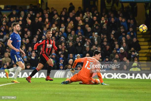 Bournemouth's English midfielder Junior Stanislas scores the team's second goal during the English Premier League football match between Chelsea and...