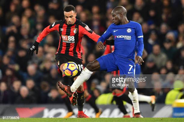Bournemouth's English midfielder Junior Stanislas vies with Chelsea's French midfielder N'Golo Kante during the English Premier League football match...