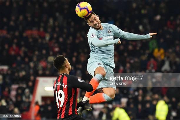 Bournemouth's English midfielder Junior Stanislas watches as Chelsea's Belgian midfielder Eden Hazard jumps to header the ball during the English...
