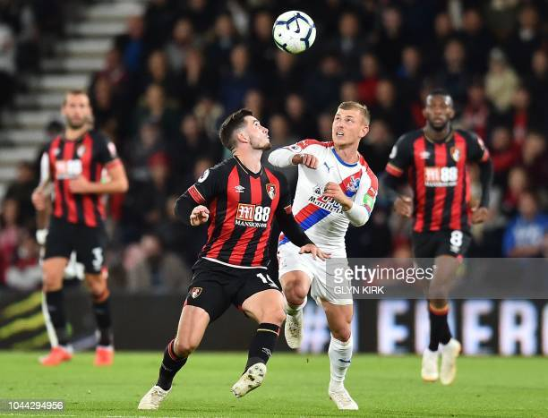 Bournemouth's English midfielder Lewis Cook vies to header the ball with Crystal Palace's German midfielder Max Meyer during the English Premier...