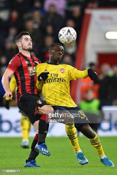 Bournemouth's English midfielder Lewis Cook vies with Arsenal's English striker Eddie Nketiah during the English FA Cup fourth round football match...