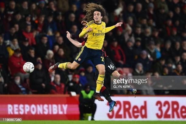 Bournemouth's English midfielder Lewis Cook vies with Arsenal's French midfielder Matteo Guendouzi during the English FA Cup fourth round football...
