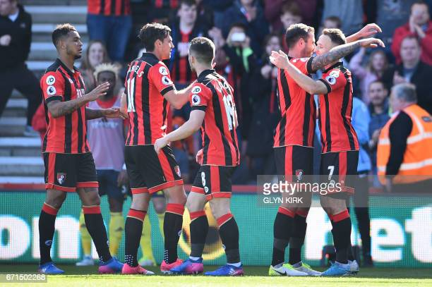 Bournemouth's English midfielder Marc Pugh celebrates after scoring their third goal during the English Premier League football match between...