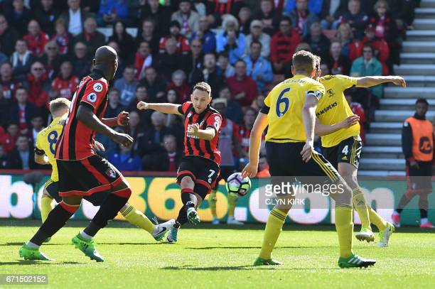 Bournemouth's English midfielder Marc Pugh shoots and scores their third goal during the English Premier League football match between Bournemouth...