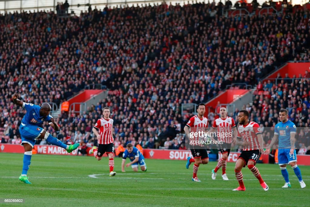 Bournemouth's English striker Benik Afobe (L) has an unsuccessful shot during the English Premier League football match between Southampton and Bournemouth at St Mary's Stadium in Southampton, southern England on April 1, 2017. The game finished 0-0. / AFP PHOTO / Adrian DENNIS / RESTRICTED TO EDITORIAL USE. No use with unauthorized audio, video, data, fixture lists, club/league logos or 'live' services. Online in-match use limited to 75 images, no video emulation. No use in betting, games or single club/league/player publications. /