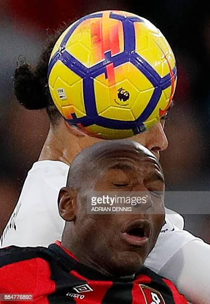 Bournemouth's English striker Benik Afobe vies for the ball with Southampton's Dutch defender Virgil van Dijk during the English Premier League...