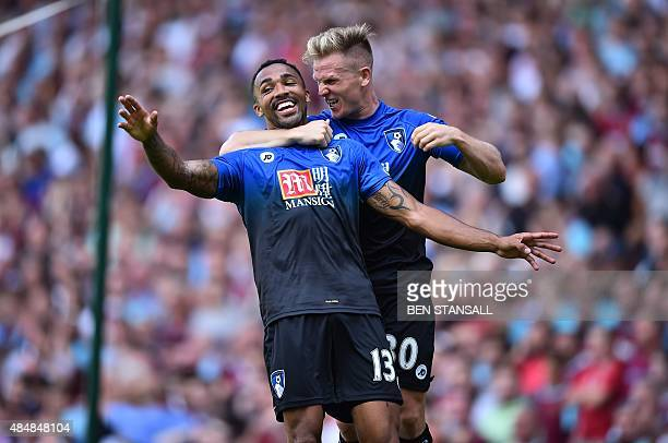 Bournemouth's English striker Callum Wilson celebrates scoring their second goal with Bournemouth's English midfielder Matt Ritchie during the...