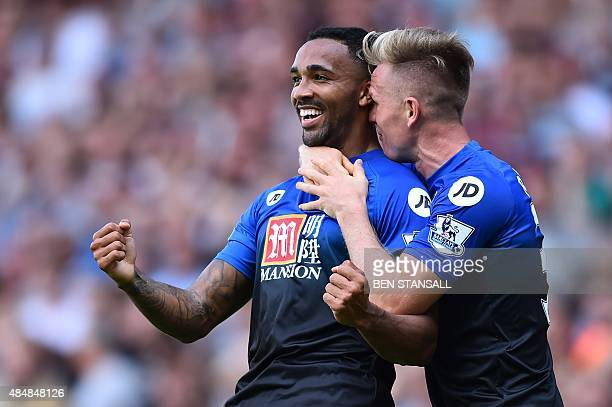 Bournemouth's English striker Callum Wilson , celebrates scoring their second goal with Bournemouth's English midfielder Matt Ritchie during the...