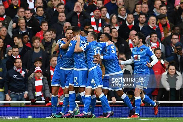 Bournemouth's English striker Callum Wilson celebrates with teammates after scoring their first goal from the penalty spot during the English Premier...