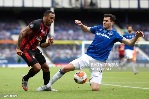 Bournemouth's English striker Callum Wilson fights for the ball with Everton's English defender Michael Keane during the English Premier League...