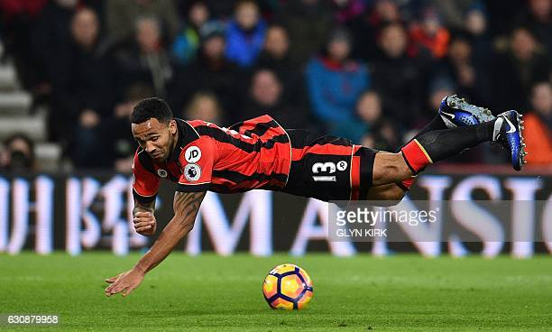 Bournemouth's English striker Callum Wilson is tripped while going in on goal during the English Premier League football match between Bournemouth...