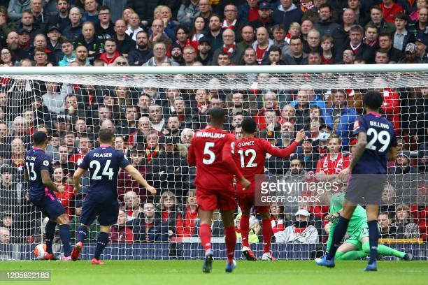 Bournemouth's English striker Callum Wilson scores his team's first goal during the English Premier League football match between Liverpool and...