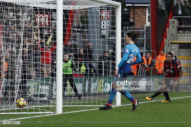 Bournemouth's English striker Callum Wilson scores his team's first goal during the English Premier League football match between Bournemouth and...