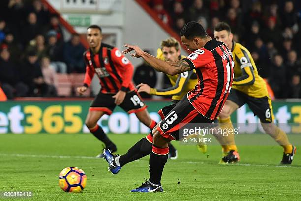 Bournemouth's English striker Callum Wilson scores their second goal from the penalty spot during the English Premier League football match between...