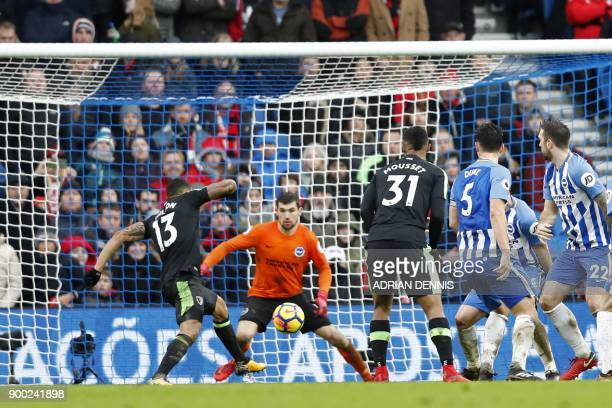 Bournemouth's English striker Callum Wilson scores their second goal after a goal-mouth scramble during the English Premier League football match...