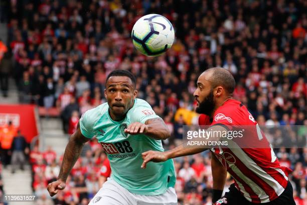 Bournemouth's English striker Callum Wilson takes on Southampton's English midfielder Nathan Redmond during the English Premier League football match...