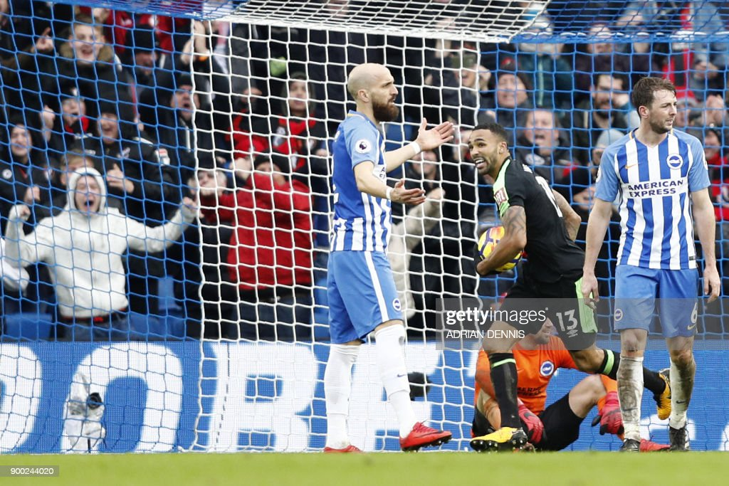 Bournemouth's English striker Callum Wilson (2nd R) turns to celebrate after scoring their second goal after a goal-mouth scramble during the English Premier League football match between Brighton and Hove Albion and Bournemouth at the American Express Community Stadium in Brighton, southern England on January 1, 2018. / AFP PHOTO / Adrian DENNIS / RESTRICTED TO EDITORIAL USE. No use with unauthorized audio, video, data, fixture lists, club/league logos or 'live' services. Online in-match use limited to 75 images, no video emulation. No use in betting, games or single club/league/player publications. /