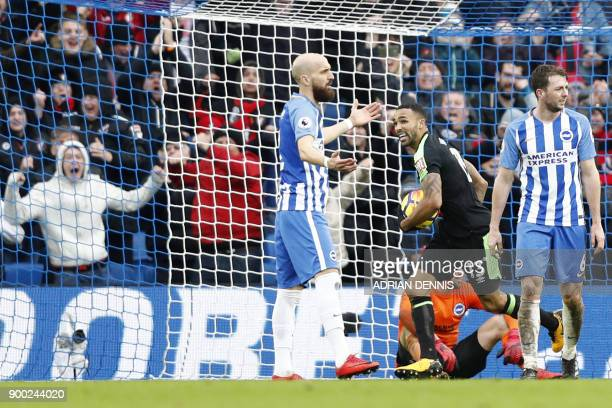 Bournemouth's English striker Callum Wilson turns to celebrate after scoring their second goal after a goal-mouth scramble during the English Premier...