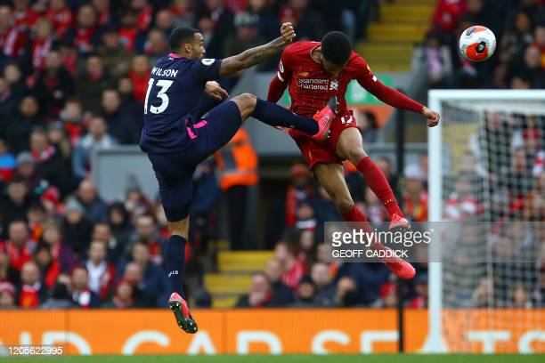 Bournemouth's English striker Callum Wilson vies with Liverpool's English defender Joe Gomez during the English Premier League football match between...