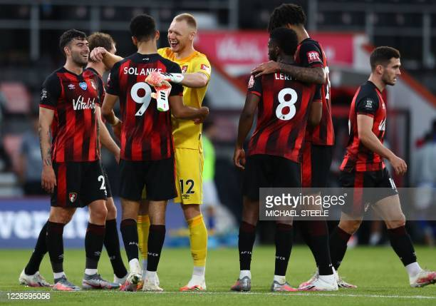 Bournemouth's English striker Dominic Solanke and Bournemouth's English goalkeeper Aaron Ramsdale celebrate after the English Premier League football...